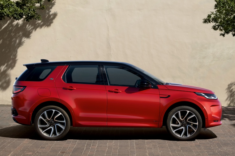Picture of a 2020 Land Rover Discovery Sport P290 HSE R-Dynamic in Firenze Red Metallic from a right side perspective