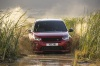 Picture of a driving 2020 Land Rover Discovery Sport P290 HSE R-Dynamic in Firenze Red Metallic from a frontal perspective