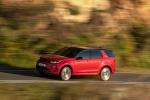 Picture of a driving 2020 Land Rover Discovery Sport P290 HSE R-Dynamic in Firenze Red Metallic from a front left three-quarter perspective