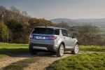 Picture of a driving 2020 Land Rover Discovery Sport P250 S in Byron Blue Metallic from a rear right three-quarter perspective