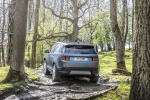 Picture of a driving 2020 Land Rover Discovery Sport P250 S in Byron Blue Metallic from a rear left perspective