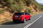 Picture of a driving 2020 Land Rover Discovery Sport P290 HSE R-Dynamic in Firenze Red Metallic from a rear right perspective