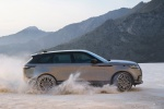 Picture of a driving 2020 Land Rover Range Rover Velar P380 R-Dynamic HSE in Silver from a side perspective