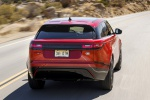 Picture of a driving 2020 Land Rover Range Rover Velar P250 R-Dynamic S in Firenze Red Metallic from a rear perspective
