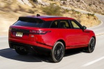 Picture of a driving 2020 Land Rover Range Rover Velar P250 R-Dynamic S in Firenze Red Metallic from a rear right three-quarter perspective