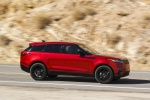Picture of a driving 2020 Land Rover Range Rover Velar P250 R-Dynamic S in Firenze Red Metallic from a right side perspective