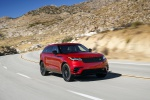 Picture of a driving 2020 Land Rover Range Rover Velar P250 R-Dynamic S in Firenze Red Metallic from a front right perspective