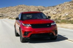 Picture of a driving 2020 Land Rover Range Rover Velar P250 R-Dynamic S in Firenze Red Metallic from a frontal perspective