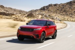 Picture of a driving 2020 Land Rover Range Rover Velar P250 R-Dynamic S in Firenze Red Metallic from a front left perspective
