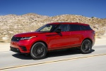 Picture of a driving 2020 Land Rover Range Rover Velar P250 R-Dynamic S in Firenze Red Metallic from a front left three-quarter perspective