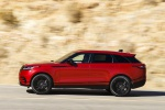 Picture of a driving 2020 Land Rover Range Rover Velar P250 R-Dynamic S in Firenze Red Metallic from a left side perspective