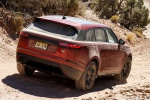 Picture of a driving 2020 Land Rover Range Rover Velar P250 R-Dynamic S in Firenze Red Metallic from a rear right perspective