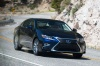 Driving 2018 Lexus ES 300h Sedan in Nightfall Mica from a front right view