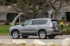 Driving 2017 Lexus GX460 in Nebula Gray Pearl from a rear left three-quarter view
