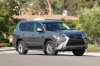 Driving 2017 Lexus GX460 in Nebula Gray Pearl from a front right view