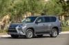 Driving 2017 Lexus GX460 in Nebula Gray Pearl from a front left three-quarter view