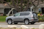 Picture of a driving 2018 Lexus GX460 in Nebula Gray Pearl from a rear left three-quarter perspective