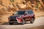 Picture of a driving 2018 Lexus GX460 Sport Design Package in Claret Mica from a front left perspective