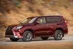 Picture of a driving 2018 Lexus GX460 Sport Design Package in Claret Mica from a front left three-quarter perspective