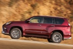 Picture of a driving 2018 Lexus GX460 Sport Design Package in Claret Mica from a side perspective