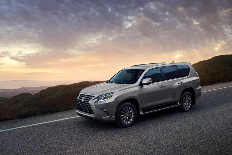 Picture of a driving 2020 Lexus GX460 in Atomic Silver from a front left three-quarter perspective