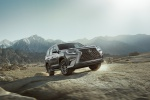 Picture of a driving 2020 Lexus GX460 in Nebula Gray Pearl from a front right perspective
