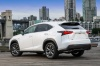 2016 Lexus NX200t F-Sport in Eminent White Pearl from a rear left three-quarter view