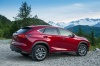 2016 Lexus NX300h in Matador Red Mica from a rear right three-quarter view