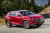 2016 Lexus NX300h in Matador Red Mica from a front right three-quarter view