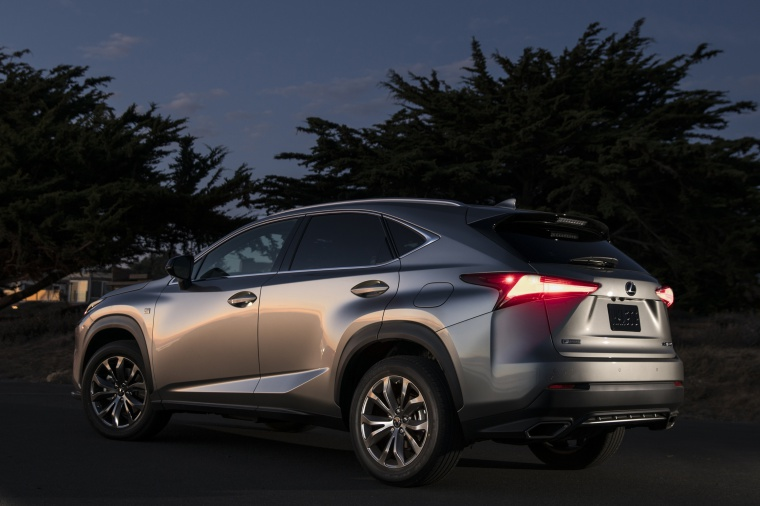 Picture of a 2019 Lexus NX300 in Atomic Silver from a rear left three-quarter perspective