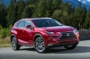 2019 Lexus NX300h in Matador Red Mica from a front right three-quarter view
