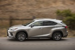 Picture of a driving 2019 Lexus NX300 in Atomic Silver from a side perspective