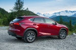 Picture of a 2019 Lexus NX300h in Matador Red Mica from a rear right three-quarter perspective
