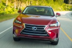 Picture of a driving 2019 Lexus NX300h in Matador Red Mica from a frontal perspective