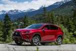 Picture of a driving 2019 Lexus NX300h in Matador Red Mica from a front left three-quarter perspective