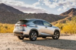 Picture of a 2019 Lexus NX300h in Atomic Silver from a rear right three-quarter perspective