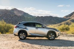 Picture of a 2019 Lexus NX300h in Atomic Silver from a side perspective