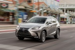 Picture of a driving 2019 Lexus NX300h in Atomic Silver from a front left perspective