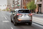 Picture of a driving 2019 Lexus NX300h in Atomic Silver from a rear perspective