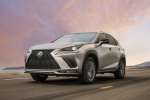 Picture of a driving 2019 Lexus NX300 in Atomic Silver from a front left perspective
