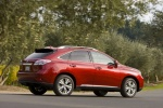 2011 Lexus RX450h in Matador Red Mica - Driving Rear Right Three-quarter View