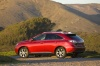 2012 Lexus RX350 in Matador Red Mica from a rear left three-quarter view