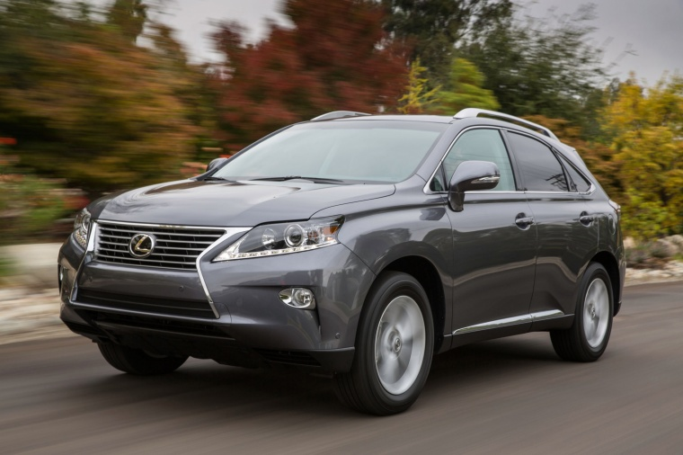 Driving 2014 Lexus RX350 in Nebula Gray Pearl from a front left three-quarter view
