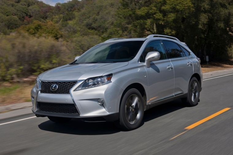 Driving 2014 Lexus RX350 F-Sport in Silver Lining Metallic from a front left three-quarter view
