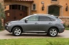 Driving 2014 Lexus RX350 in Nebula Gray Pearl from a side view