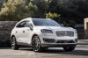 Picture of a 2019 Lincoln Nautilus 2.7T AWD in White Platinum Metallic Tri-Coat from a front right perspective