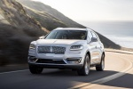 Picture of a driving 2020 Lincoln Nautilus 2.7T AWD in Ceramic Pearl from a front left perspective
