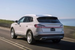 Picture of a driving 2020 Lincoln Nautilus 2.7T AWD in Ceramic Pearl from a rear left three-quarter perspective