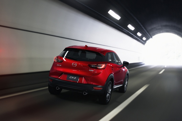 Driving 2017 Mazda CX-3 in Soul Red Metallic from a rear right view