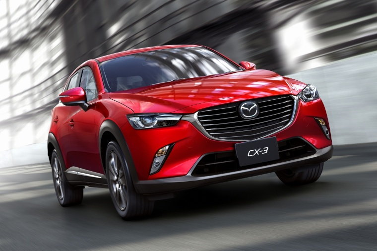 Driving 2017 Mazda CX-3 in Soul Red Metallic from a front right view
